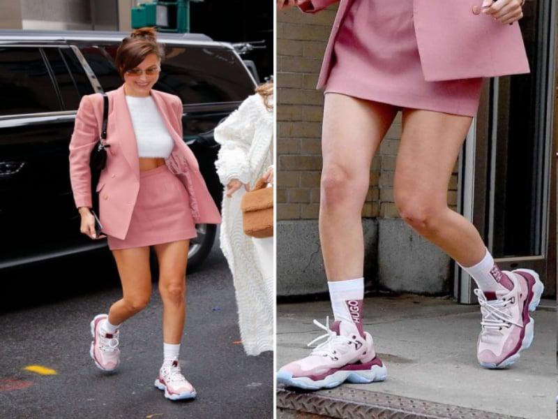 Phối giày màu hồng cùng quần short khoe chân dài miên man